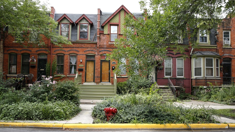 This Friday, Aug. 22, 2014, photo shows the Pullman neighborhood's ornate brick homes that were built in the 1800s by industrialist George Pullman as a blue-collar utopia to house workers from his sleeping-railcar factory in Chicago. National Park Service Director Jonathan B. Jarvis tells The Associated Press that he plans to recommend that the Interior Secretary ask President Obama to declare the southeast Chicago neighborhood a unit of the national park system. (AP Photo/Charles Rex Arbogast)