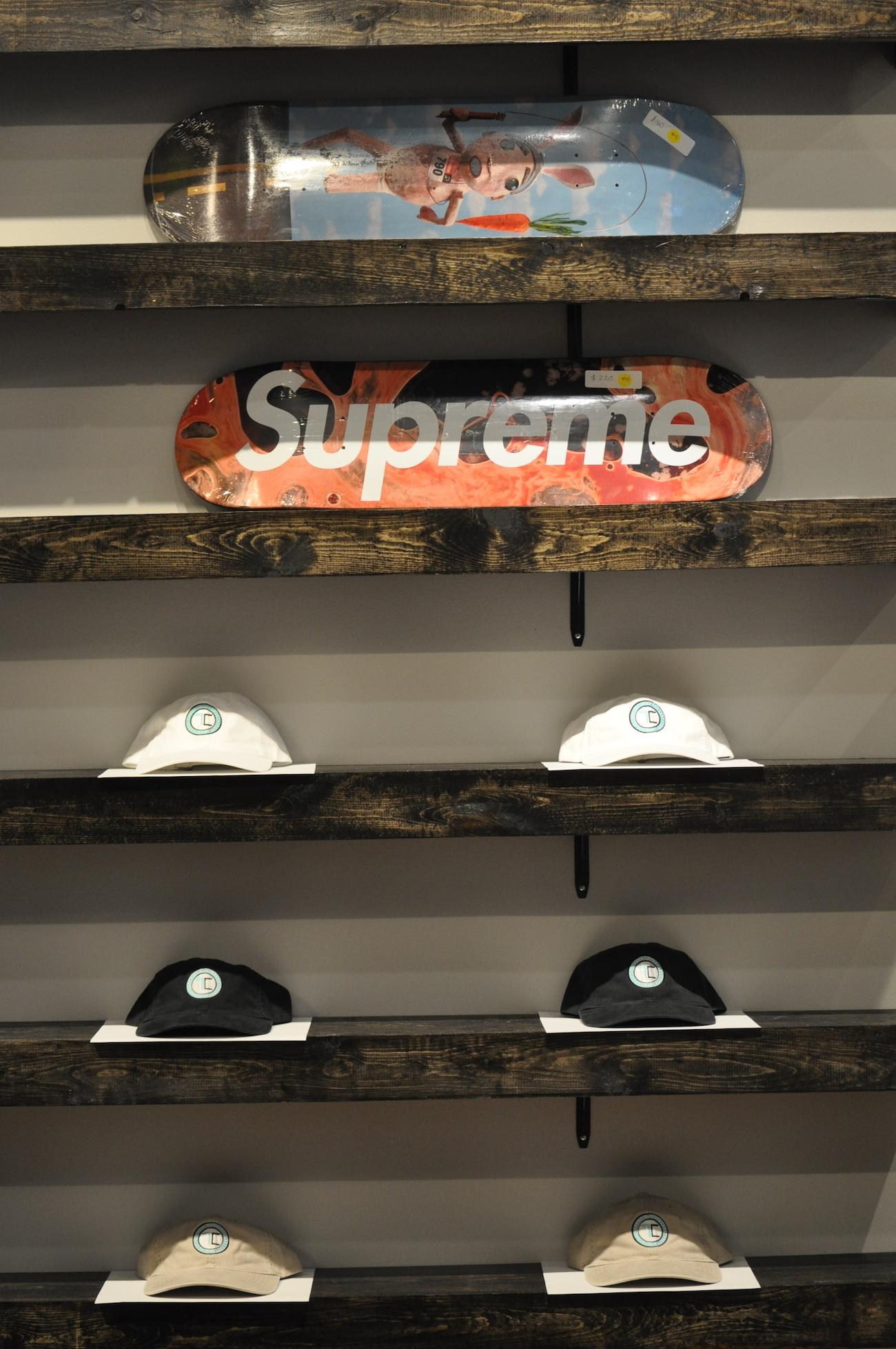In addition to sneakers, The Cure Cincinnati also carries  clothing, hats, and other items by the likes of Bape, Fear of God, and Supreme, including pieces from the brand's collaboration with Louis Vuitton.  / Image: Jennifer Merritt