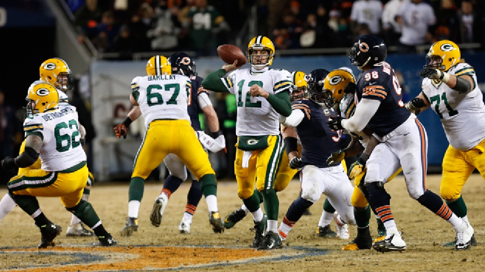 Green Bay Packers quarterback Aaron Rodgers (12) passes during the second half of a game against the Chicago Bears, Sunday, Dec. 29, 2013, in Chicago. (AP Photo/Charles Rex Arbogast)