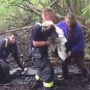 Authorities rescue dog stuck in mud