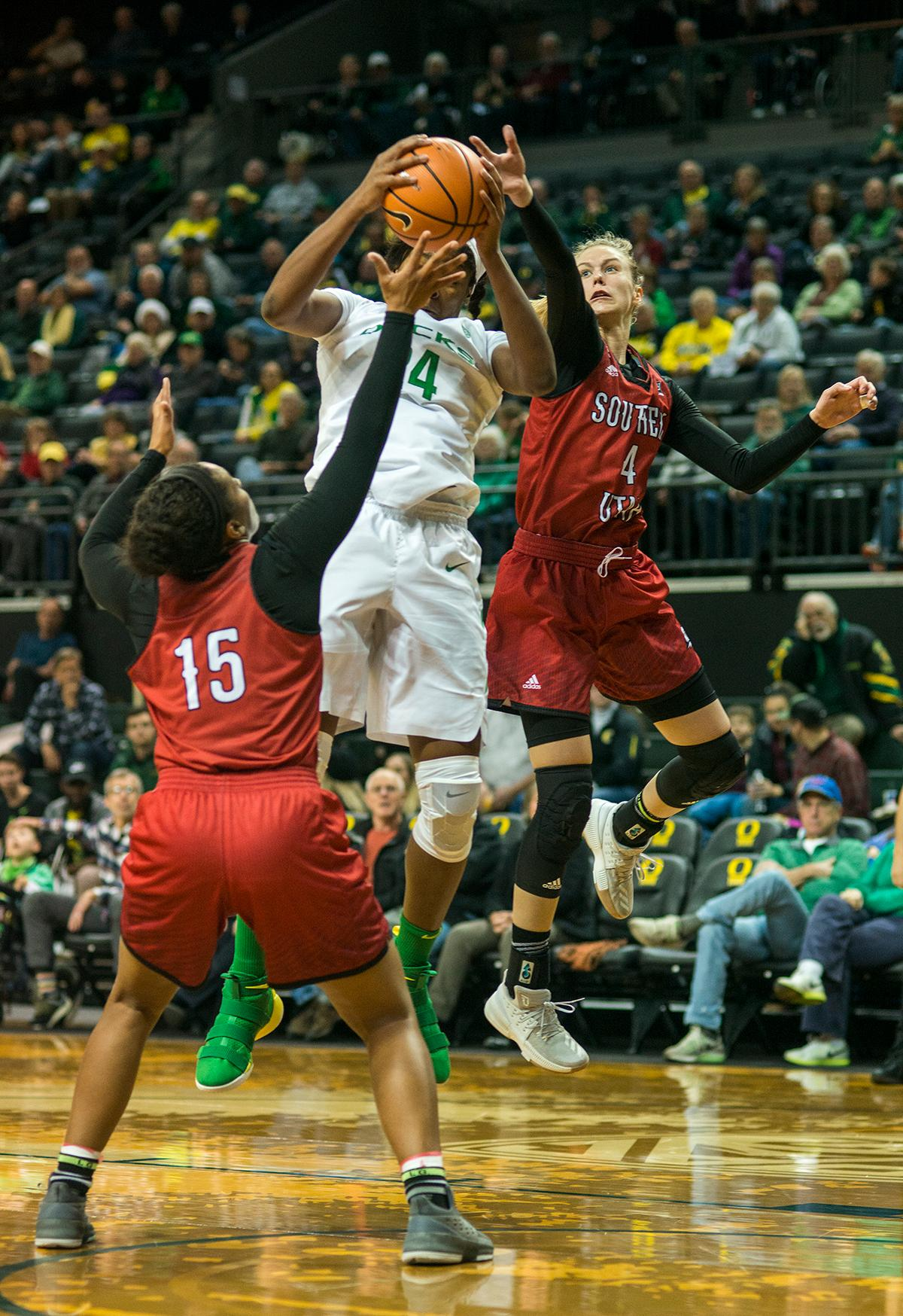 Oregon Ducks Ruthy Heard (#24) attempts to keep control of the ball. The University of Oregon Ducks women basketball team defeated the Southern Utah Thunderbirds 98-38 in Matthew Knight Arena Saturday afternoon. The Ducks had four players in double-digits: Ruthy Hebard with 13; Mallory McGwire with 10; Lexi Bando with 17 which included four three-pointers; and Sabrina Ionescu with 16 points. The Ducks overwhelmed the Thunderbirds, shooting 50% in field goals to South Utah's 26.8%, 53.8% in three-pointers to 12.5%, and 85.7% in free throws to 50%. The Ducks, with an overall record of 8-1, and coming into this game ranked 9th, will play their next home game against Ole Miss on December 17. Photo by Rhianna Gelhart, Oregon News Lab