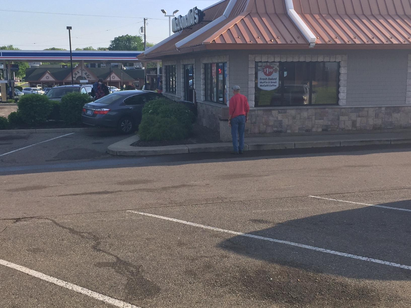 A car crashed into the McDonald's on Capital Avenue in Battle Creek Friday morning. (WWMT/Jason Puhr)