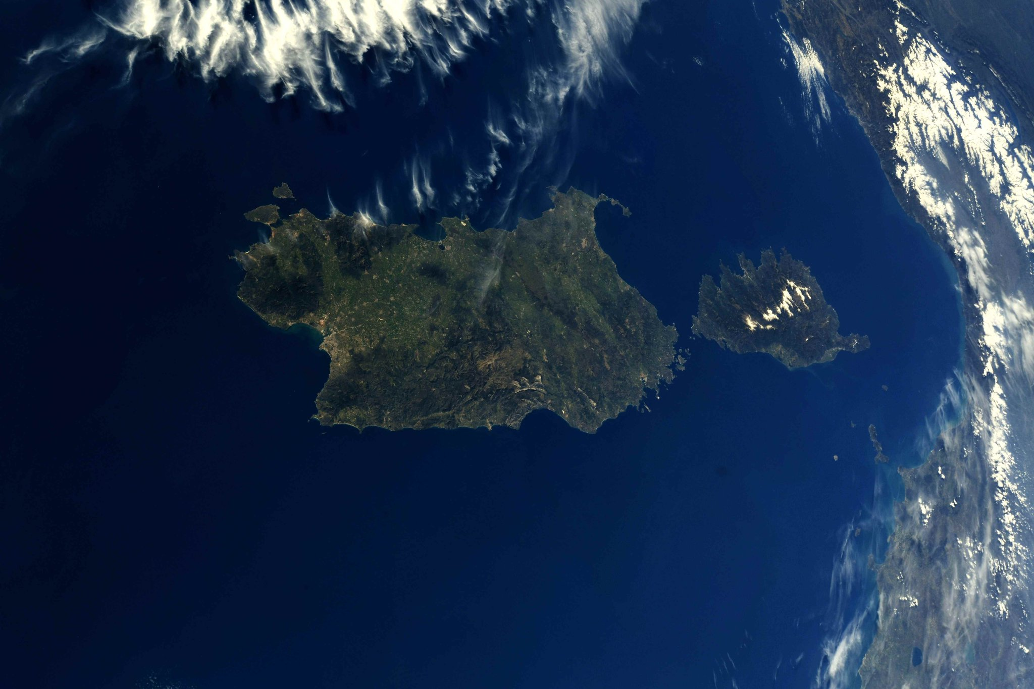 The islands of #Sardinia and #Corsica bathed in sunshine and the tranquil waters of the #Mediterranean. (Photo & Caption: Ricky Arnold / NASA)