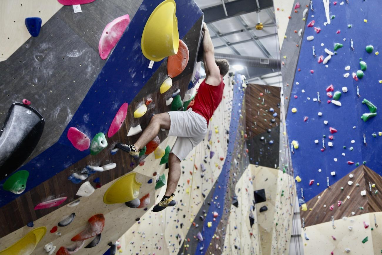 Joey from College Hill works his way up a bouldering problem.{ }/ Image: Chez Chesak // Published: 2.1.20{ }