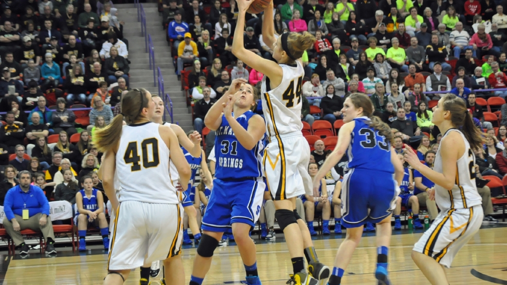 Algoma's Anna Dier grabs a rebound during a Division 4 state semifinal game against St. Mary's Springs on Thursday. (Doug Ritchay/WLUK)