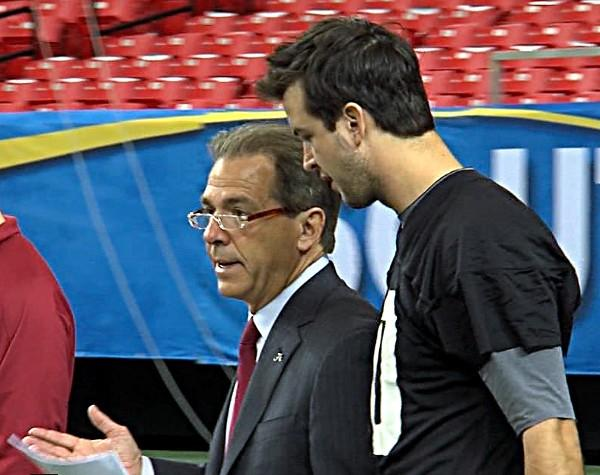 Alabama head coach Nick Saban talks with AJ McCarron during a walk through in the Georgia Dome on Friday.