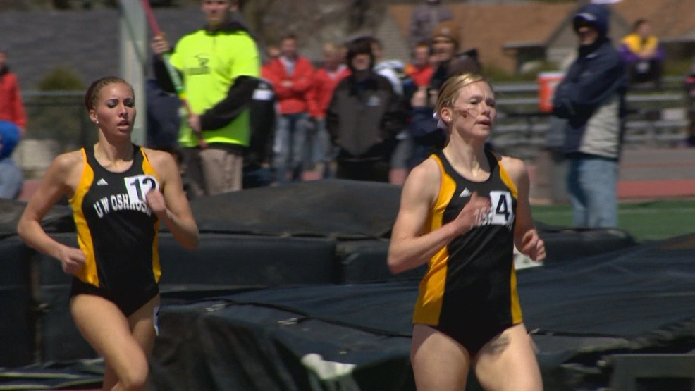 Christy Cazzola of UW-Oshkosh crosses the finish line first in the 1500 meter run.