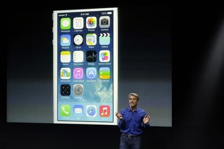 Craig Federighi, senior vice president of Software Engineering at Apple, speaks about the new iOS 7 release in Cupertino, Calif., Tuesday, Sept. 10, 2013.