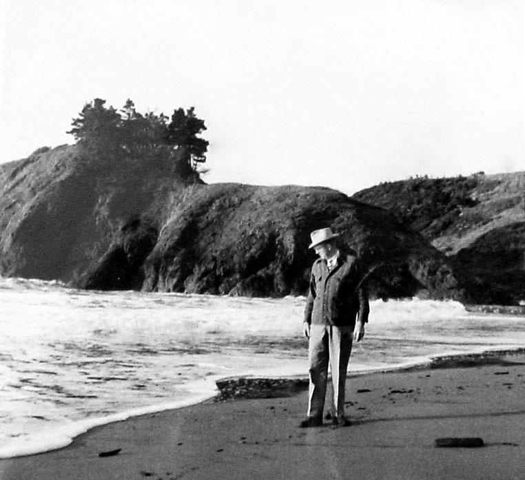 Bob Straub walks along the Oregon coast and looks out at the ocean. (Western Oregon University Archives - Robert W. Straub Collection/Used with permission)