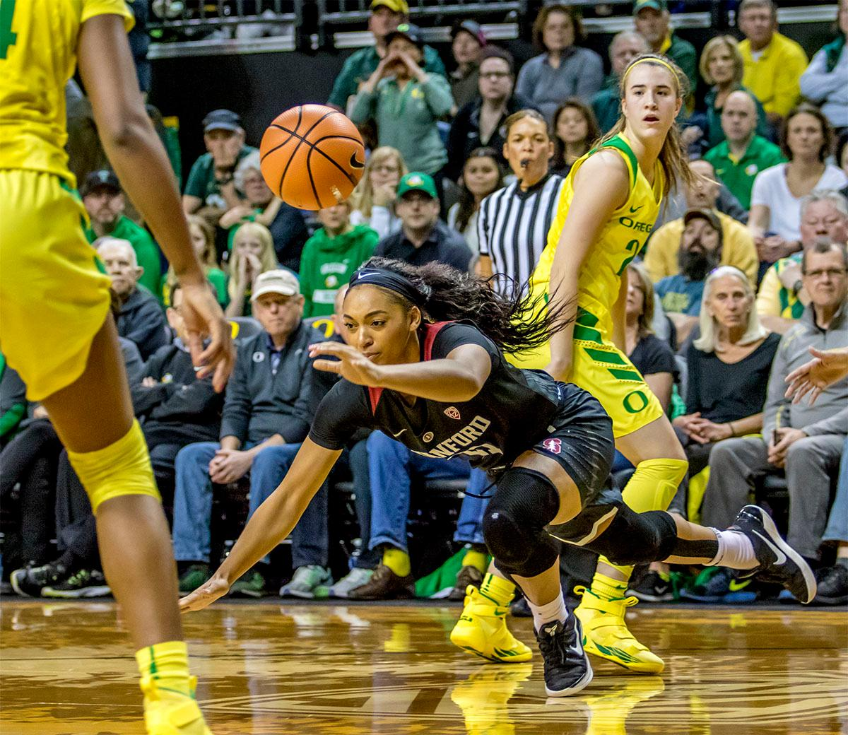 A Stanford players takes a tumble losing the ball. The Stanford Cardinal defeated the Oregon Ducks 78-65 on Sunday afternoon at Matthew Knight Arena. Stanford is now 10-2 in conference play and with this loss the Ducks drop to 10-2. Leading the Stanford Cardinal was Brittany McPhee with 33 points, Alanna Smith with 14 points, and Kiana Williams with 14 points. For the Ducks Sabrina Ionescu led with 22 points, Ruthy Hebard added 16 points, and Satou Sabally put in 14 points. Photo by August Frank, Oregon News Lab