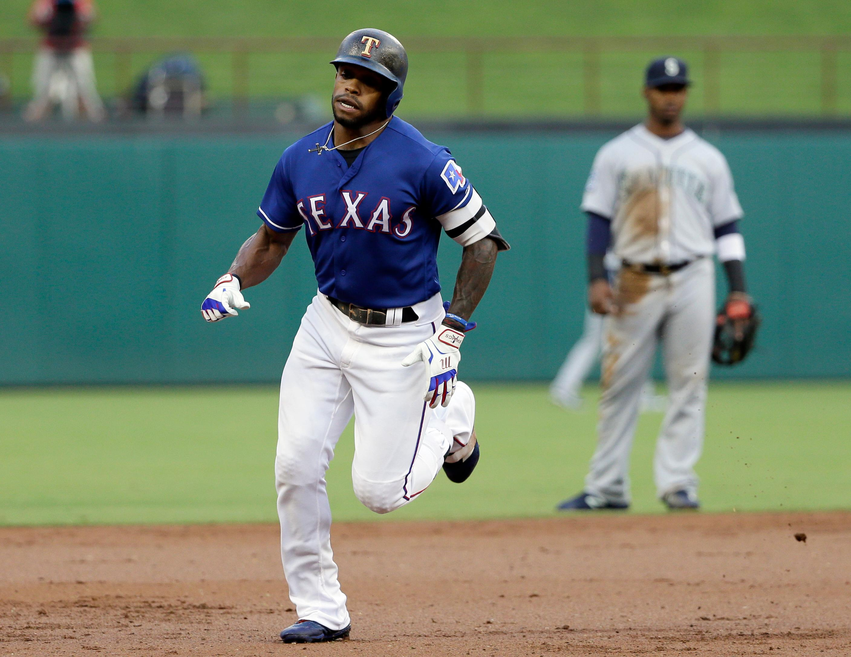 Texas Rangers' Delino DeShields rounds the bases after hitting a leadoff solo home run, as Seattle Mariners shortstop Jean Segura, rear, watches during the first inning of a baseball game, Wednesday, Aug. 2, 2017, in Arlington, Texas. (AP Photo/Tony Gutierrez)