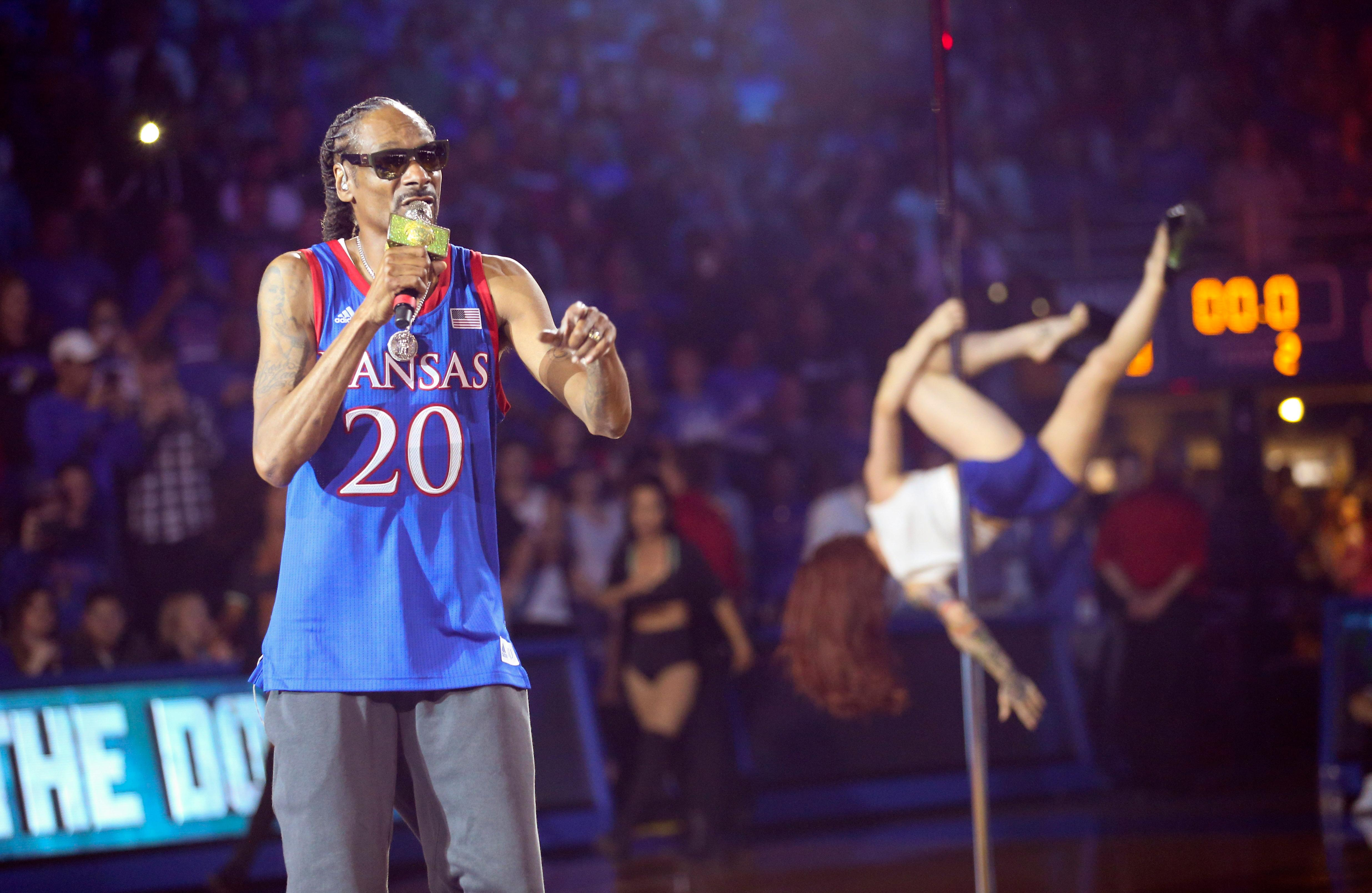 In this Friday, Oct. 4, 2019 photo, rapper Snoop Dogg performs during Late Night in the Phog, Kansas' annual NCAA college basketball kickoff, at Allen Fieldhouse in Lawrence, Kan. (Nick Krug/The Lawrence Journal-World via AP)