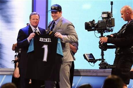 Luke Joeckel, from Texas A&M, stands with NFL Commissioner Roger Goodell after being selected second overall by the Jacksonville Jaguars in the first round of the NFL football draft, Thursday night.