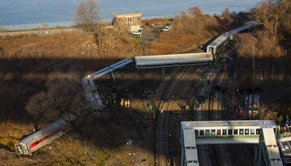 First responders gather around the derailment of a Metro-North passenger train in the Bronx borough of New York on Sunday, December 1. Of eight train cars, seven were off the tracks.