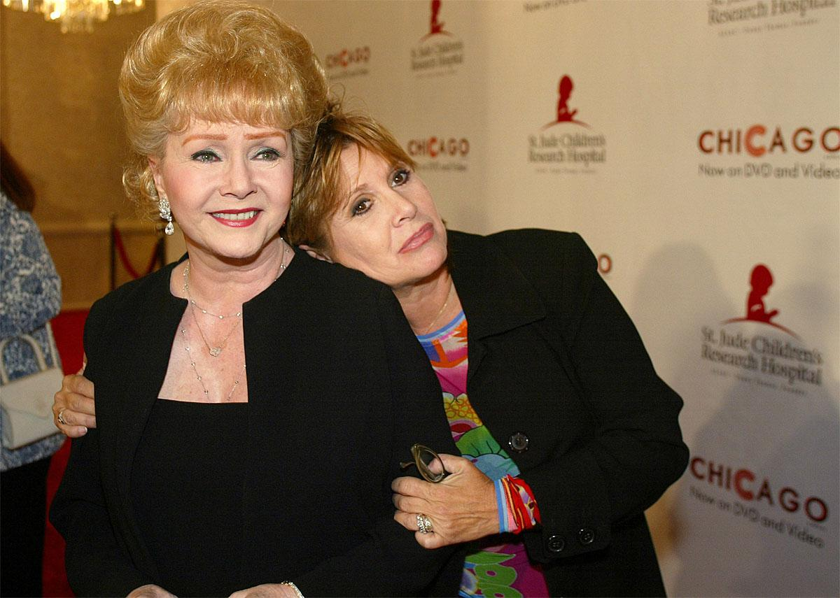 "FILE - In this Tuesday, Aug. 19, 2003 file photo, Debbie Reynolds and Carrie Fisher arrive at the ""Runway for Life"" Celebrity Fashion Show Benefitting St. Jude's Children's Research Hospital and celebrating the DVD relese of Chicago in Beverly Hills, Calif.  (AP Photo/Jill Connelly, File)"