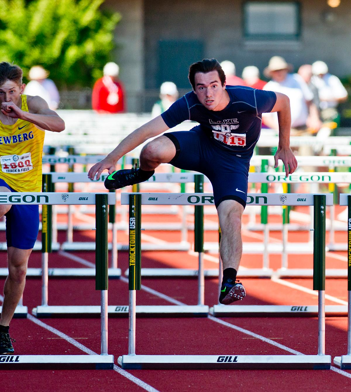 Carter Bracken fromn Lake Oswego wins the 6A Boys 110 meter Hurdles with a time of 14.24 at the OSAA Championship at Hayward Field this Saturday. Photo by Dan Morrison, Oregon News Lab