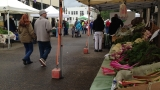 Rain doesn't keep crowds away from first Wednesday Farmers Market
