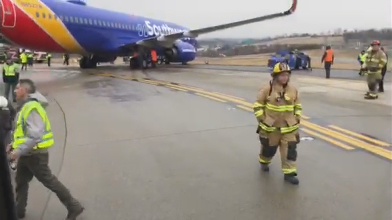 Passengers exit a Southwest Airlines airplane after it slid sideways on a taxiway during takeoff at Baltimore-Washington International Thurgood Marshall Airport, Wednesday, Feb. 7, 2018. (Courtesy of witness)