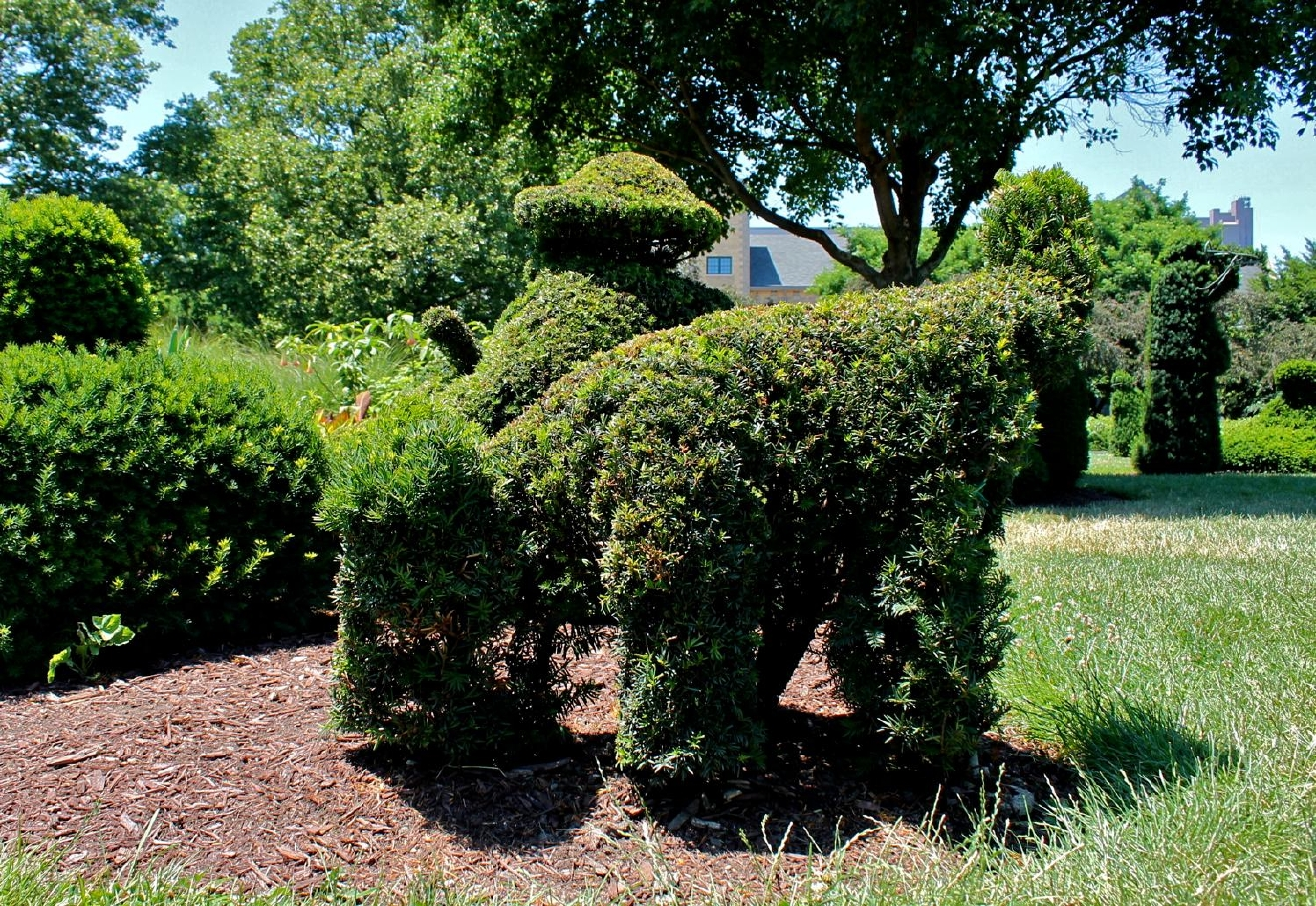 "Inspired by George Seurat's famous painting ""A Sunday Afternoon on the Isle of La Grand Jatte,"" the Topiary Park is part garden, part sculpture. This ""landscape of a painting of a landscape"" is located at 480 East Town Street, Columbus, OH, 43215. / Image: Rose Brewington"