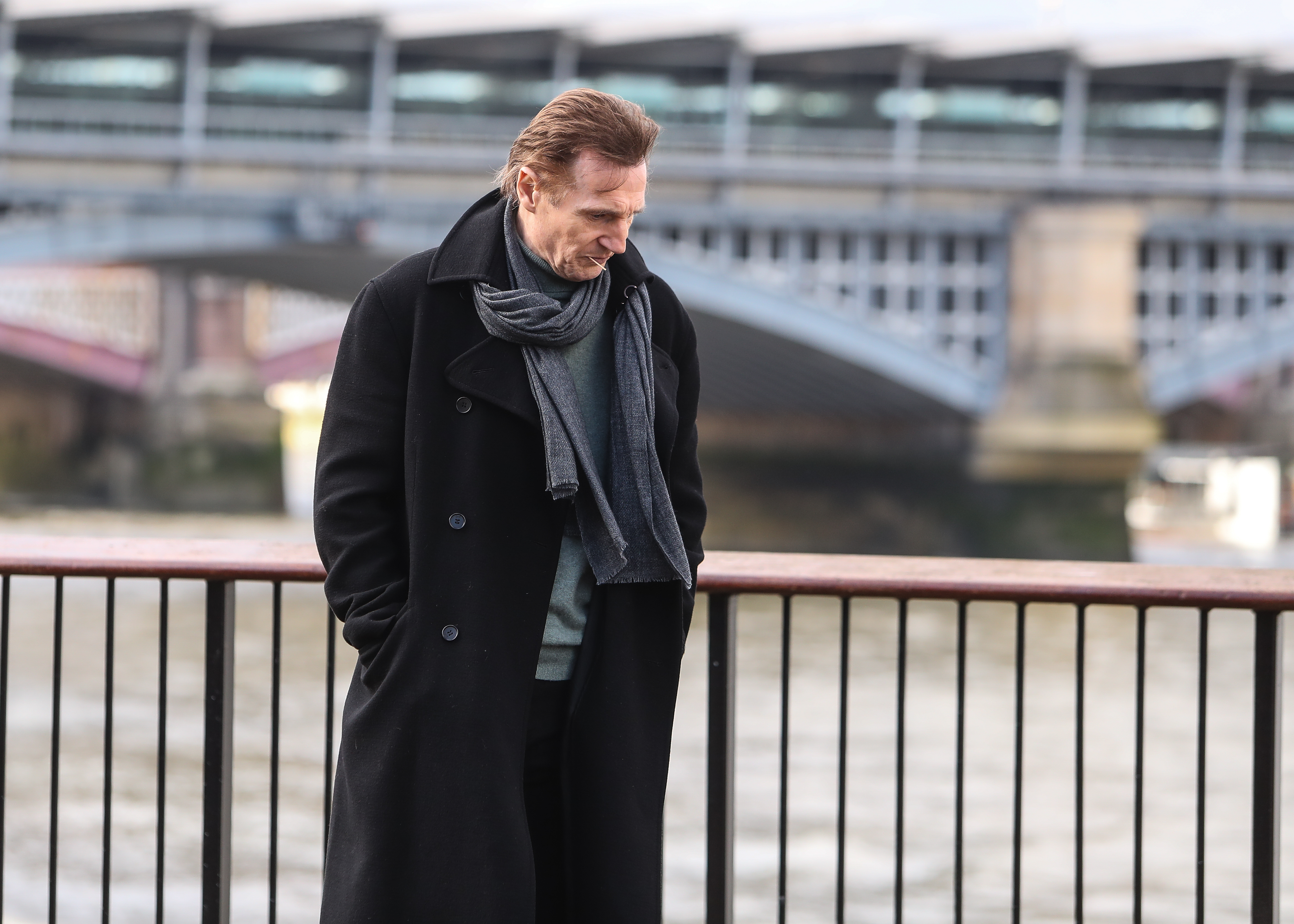 Liam Neeson, Olivia Olsen and Thomas Brodie-Sangster film a scene for a short of 'Love Actually', directed by Richard Curtis, on the South Bank in London                                    Featuring: Liam Neeson                  Where: London, United Kingdom                  When: 16 Feb 2017                  Credit: WENN.com