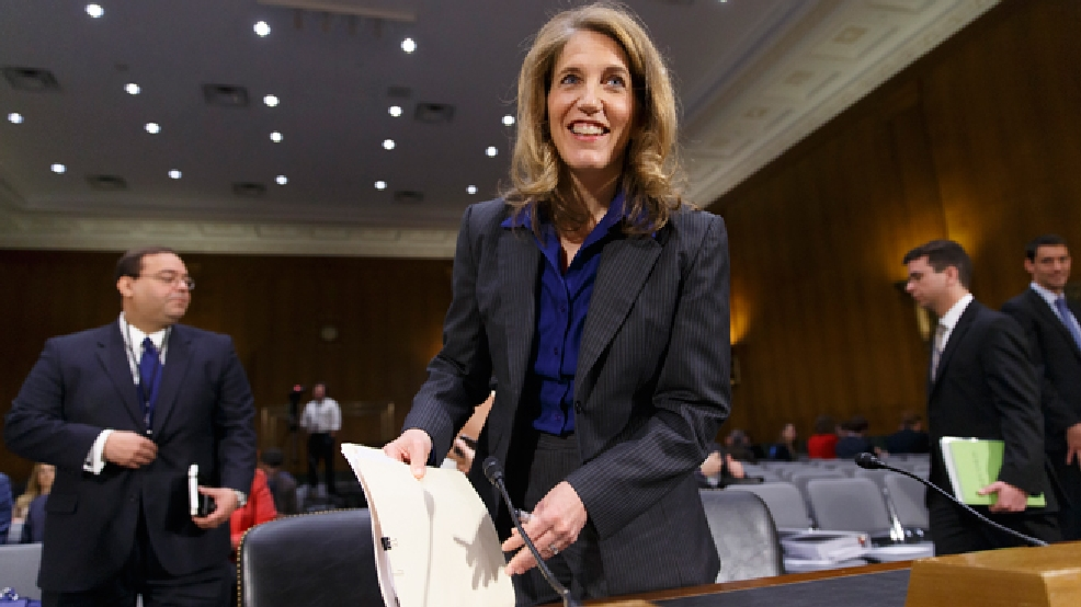 Sylvia Mathews Burwell, President Barack Obama's nominee to become secretary of Health and Human Services, arrives at the Senate Health, Education, Labor and Pensions Committee for her confirmation hearing, on Capitol Hill in Washington, Thursday, May 8, 2014. (AP Photo/J. Scott Applewhite)