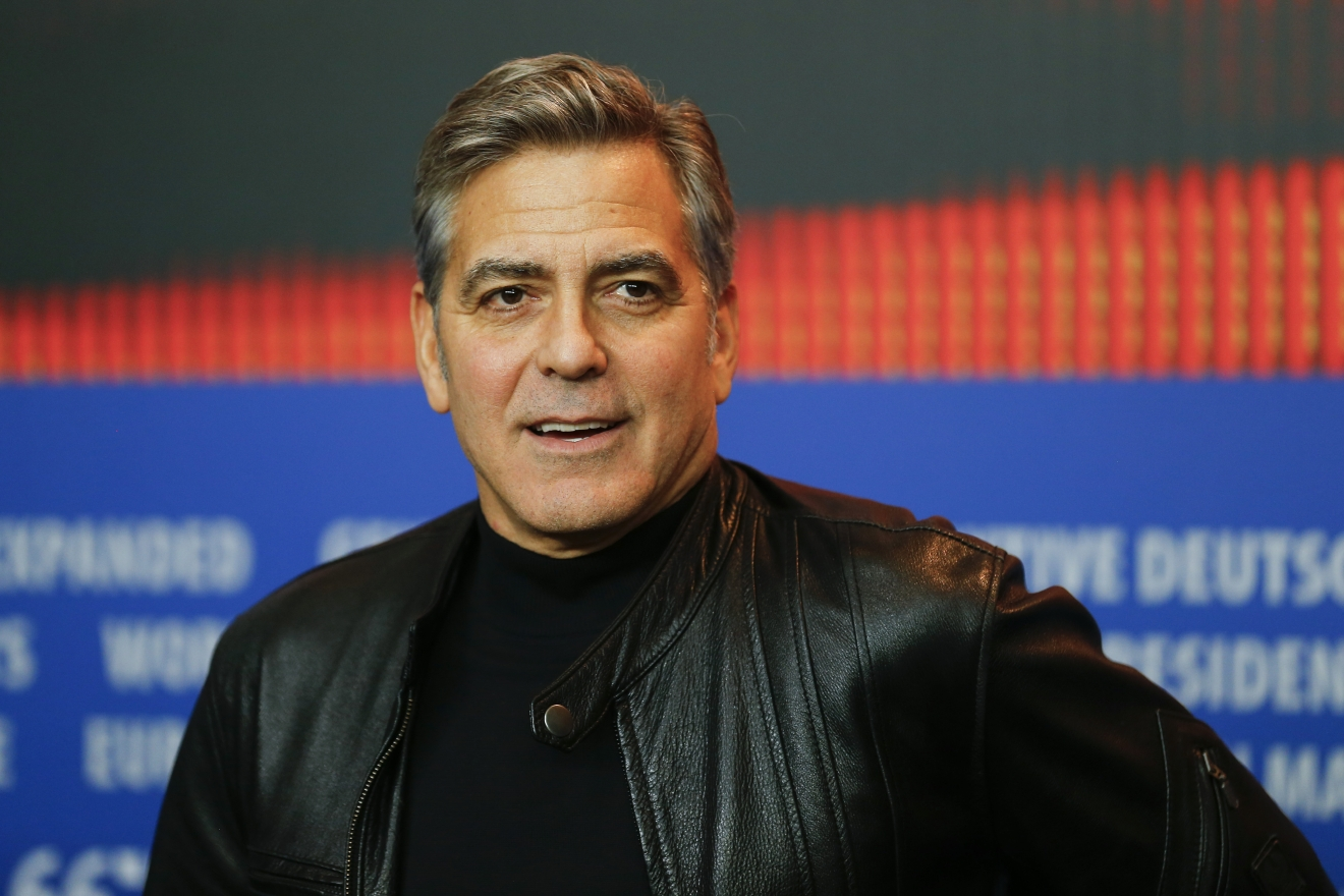 "FILE - In this Feb. 11, 2016, file photo, actor George Clooney attends a news conference for the film ""Hail Caesar"" at the 2016 Berlinale Film Festival in Berlin. (AP Photo/Axel Schmidt, File)"
