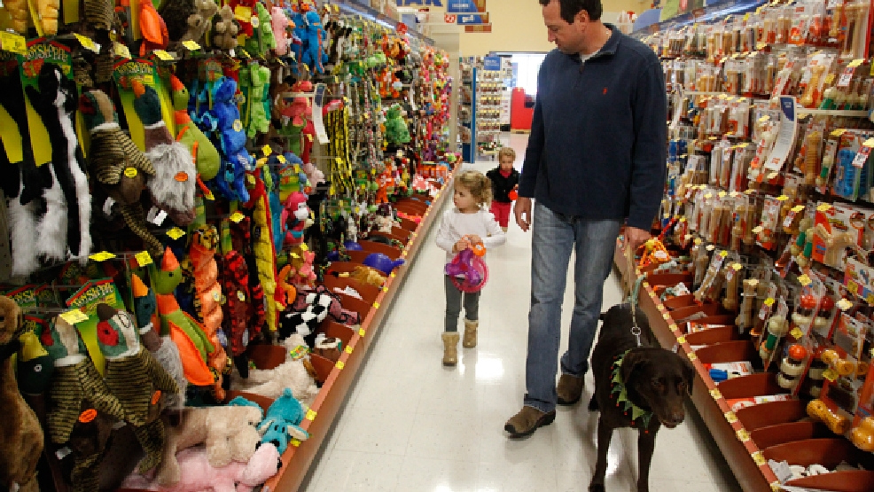 A family shops for new pet toys during the Black Friday sale at a Dallas PetSmart Friday, Nov. 29, 2013. (Richard W. Rodriguez/ AP Images for PetSmart)