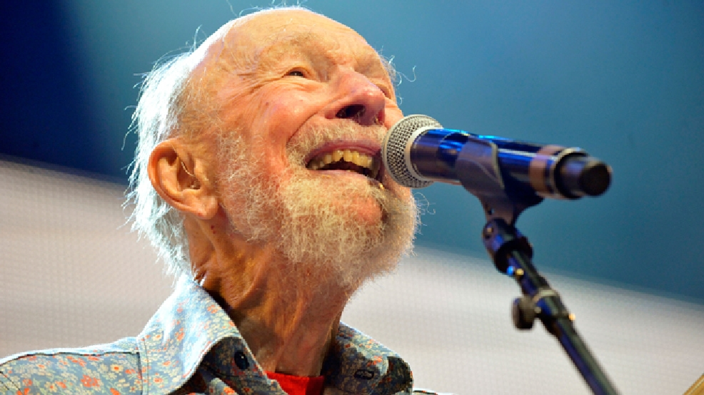 File-This Sept. 21, 2013, file photo shows Pete Seeger performing on stage during the Farm Aid 2013 concert at Saratoga Performing Arts Center in Saratoga Springs, N.Y. The American troubadour, folk singer and activist Seeger died Monday Jan. 27, 2014, at age 94. (AP Photo/Hans Pennink, File)