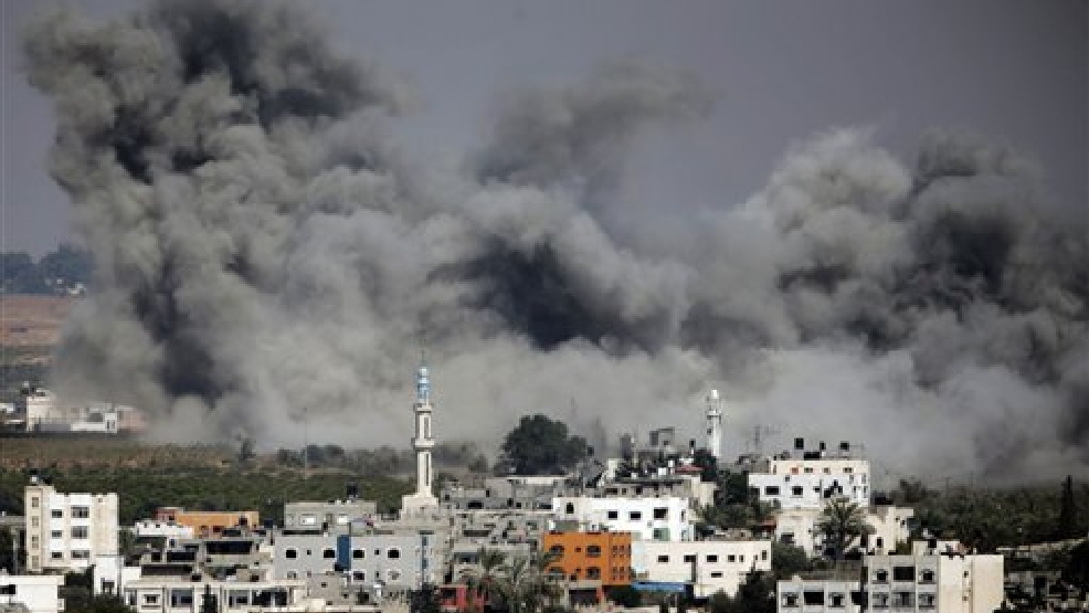 Smoke rises after an Israeli strike hit Gaza City, northern Gaza Strip, Thursday, July 31, 2014. (AP Photo/Lefteris Pitarakis)