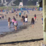 Tourists hit the beach to beat the heat