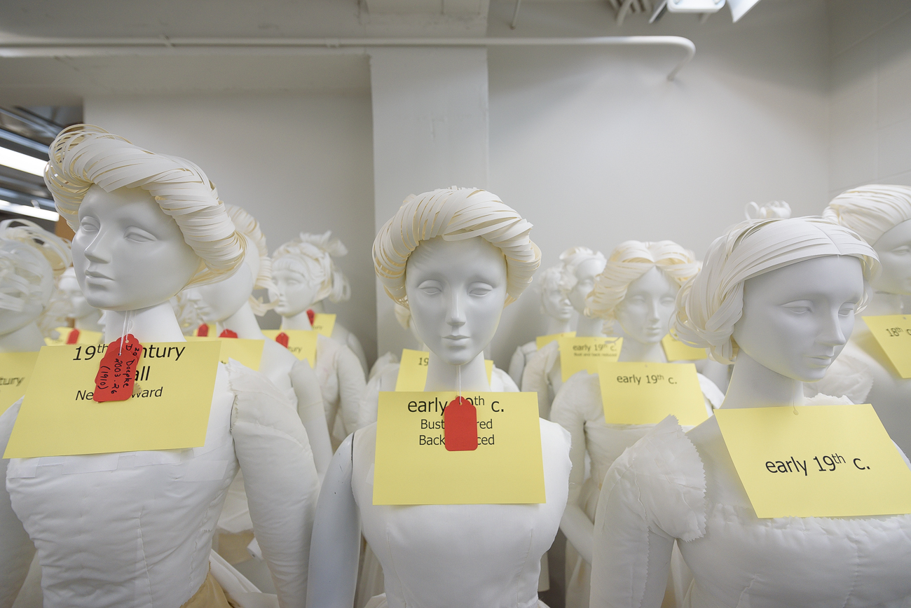 Rows of mannequins line the wall in a corner of the archive. Japanese-made, they reflect the body sizes of women in the 19th century. Cynthia Amneus, Chief Curator, explains that these mannequins are used only when the museum shows 19th-century fashion; garments from that century do not appear on modern mannequins. / Image: Phil Armstrong, Cincinnati Refined // Published: 2.18.20