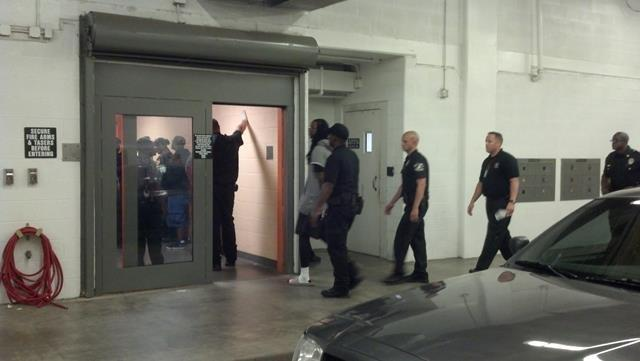 2 Chainz is led into the Oklahoma County Jail