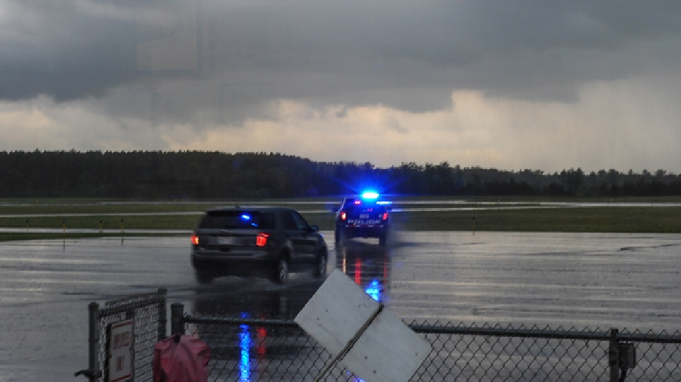 A Stevens Point Police Department vehicle heads back out to the scene of a plane crash at the Stevens Point Air Show, Sunday, June 1, 2014, in Stevens Point, Wis. (AP Photo/Stevens Point Journal Media, B.C. Kowalski)