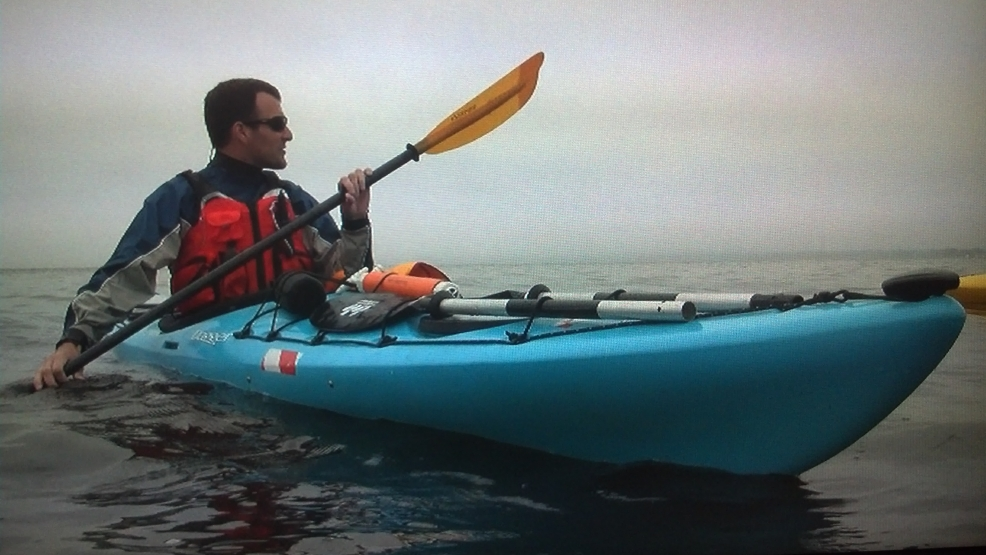 Kayak instructor Matt Kriese paddles in the waters of Green Bay