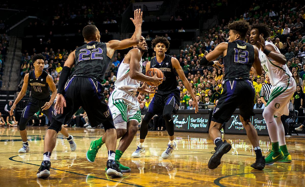 Oregon Ducks forward Troy Brown, Jr., rushes the basket as the Washington Huskies defense circles. The Oregon Ducks defeated the Washington Huskies 65-40 on Thursday night at Matthew Knight Arena. Troy Brown, Junior led Oregon with 21 points to match his career high, and Kenny Wooten set a career best of seven shots blocked. The Ducks now stand 6-5 in the Pac-12 conference play. Photo by Abigail Winn, Oregon News Lab
