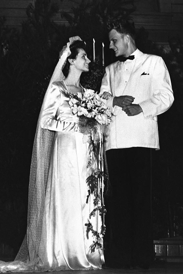 Billy Graham and Ruth McCue Bell were married on Aug. 13, 1943. Ruth made her own wedding dress with the help of a local seamstress. To avoid wrinkles on her wedding day, she stood as best she could in the back seat of her father's car on the drive to Gaither Chapel. (Photo:  Billy Graham Evangelistic Association)