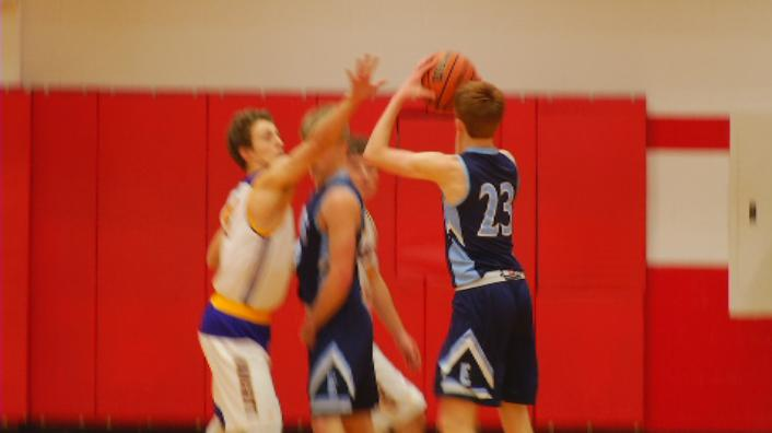 Devin Bassett shoots a three over the North Henderson defense (WLOS Staff).jpg