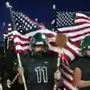 Burroughs High School football players put on patriotic display during Friday night game