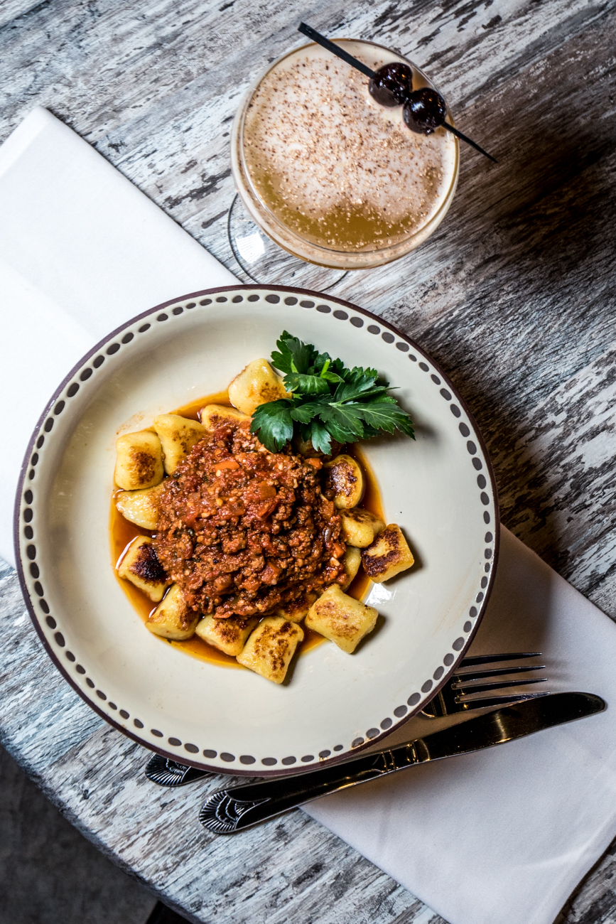 Gnocchi Bolognese: braised beef and veal sauce, marinara, and parmesan{ }paired with a Disaronno Sour / Image: Catherine Viox // Published: 4.21.20