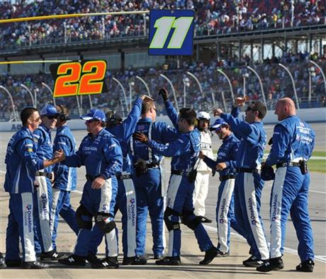 Elliott Sadler's crew celebrates after Sadler won the NASCAR Aaron's 312 Nationwide series auto race at Talladega Superspeedway, Saturday, May 3, 2014, in Talladega, Ala.