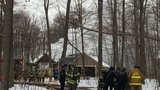 Crews fight fire at house in wooded area of Riga