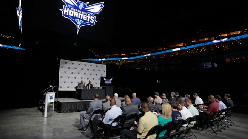 Charlotte Hornets executives speak during a news conference to announce officially changing the NBA basketball team's name from Bobcats to Hornets in Charlotte, N.C., Tuesday, May 20, 2014. (AP Photo/Chuck Burton)