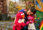 Homeless_Lily_Elmo_Hug.jpg