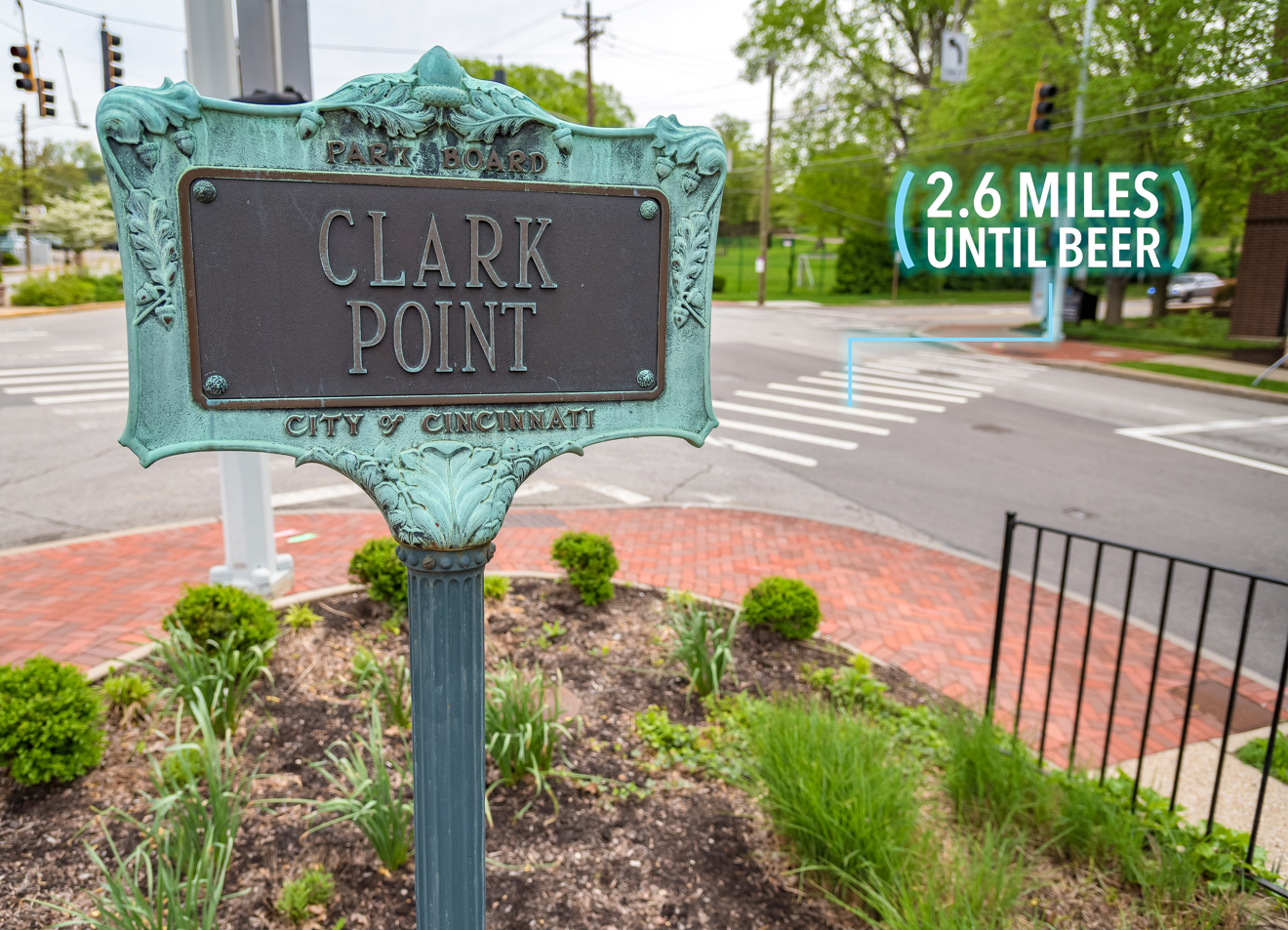You'll come upon Clark Point, a tiny little triangular park at the corner of Madison Road, Torrence Parkway, and Grandin Road. Cross the street and stay on Madison Road. / Image: Phil Armstrong, Cincinnati Refined // Published: 4.25.17
