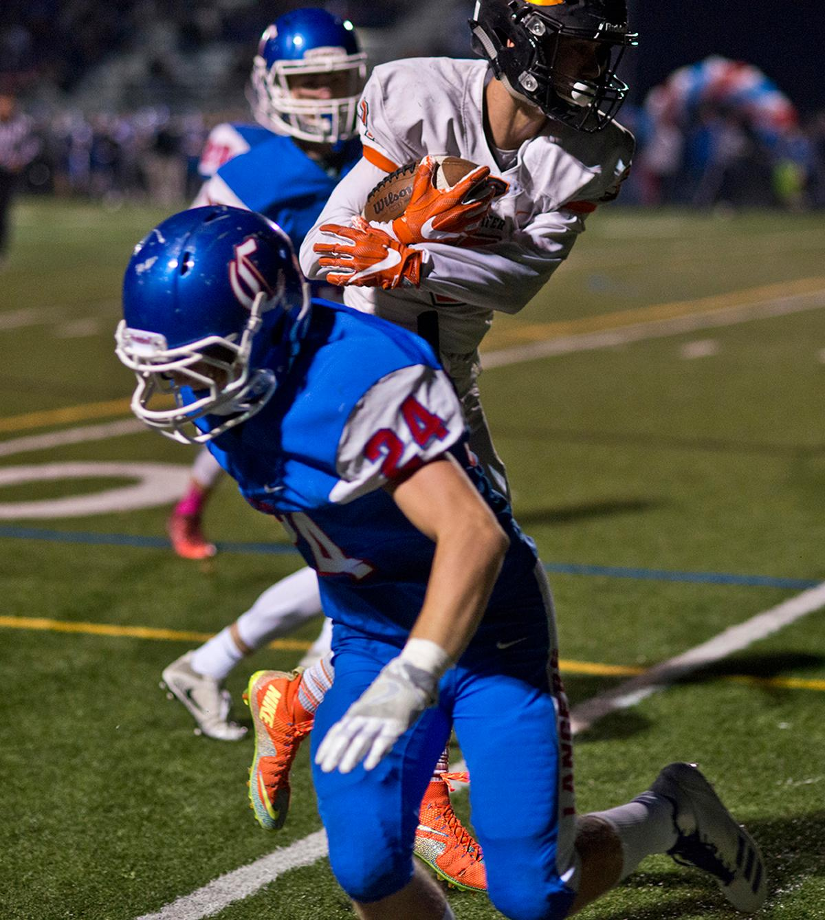 Crater Comets wide receiver Bailee Robles (#3) slips past Churchill Lancers defensive back Evan Powell (#24) to rack up yardage. Churchill defeated Crater 63-21 on Friday at their homecoming game. Churchill remains undefeated with a conference record of 9-0. Photo by Dan Morrison, Oregon News Lab