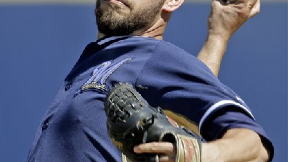 Milwaukee Brewers' Marco Estrada throws before the first inning of an exhibition spring training baseball game against the Chicago Cubs Monday, March 3, 2014, in Phoenix. (AP Photo/Morry Gash)