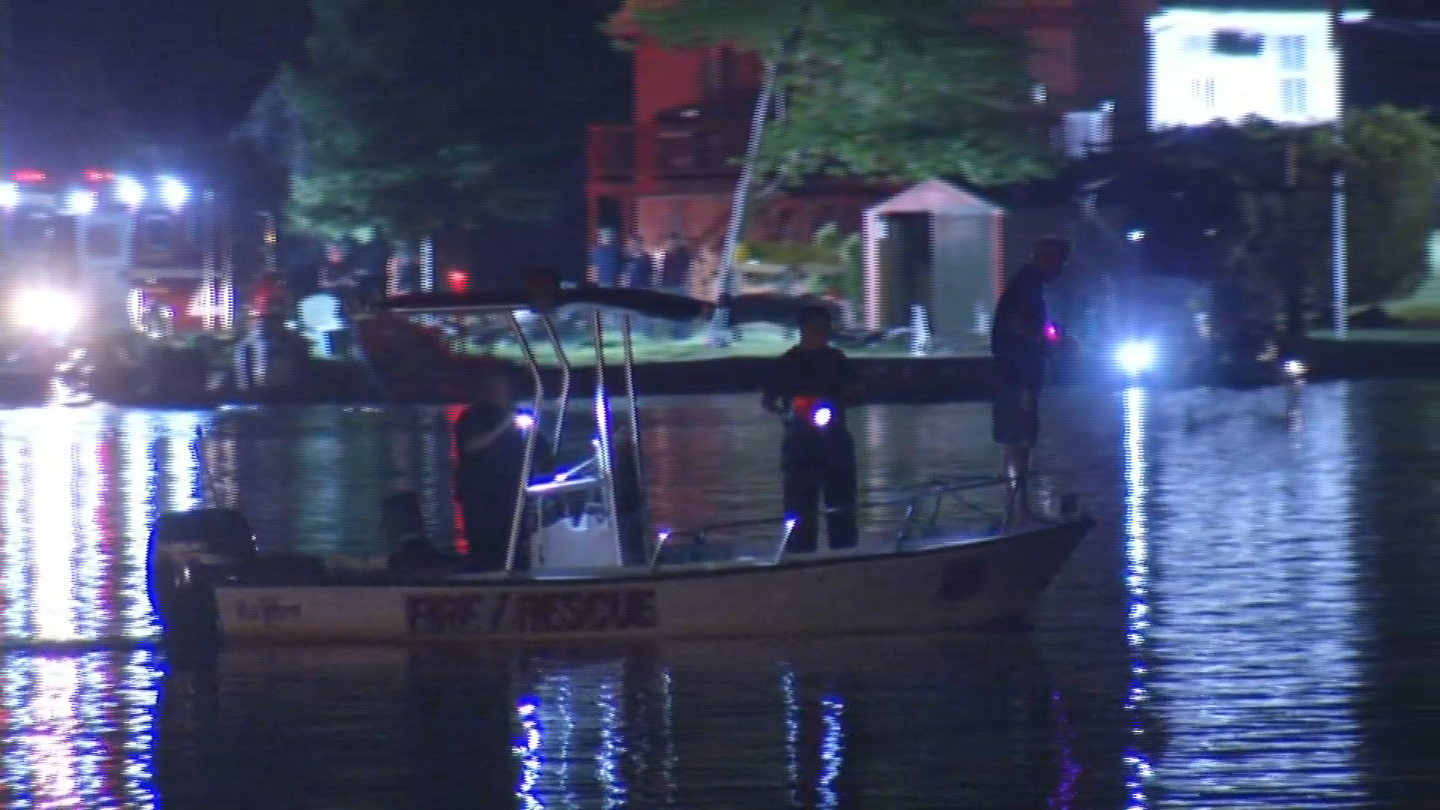 Fire and rescue crews search Johnson's Pond in Coventry for two men reported overboard from a boat. (WJAR)