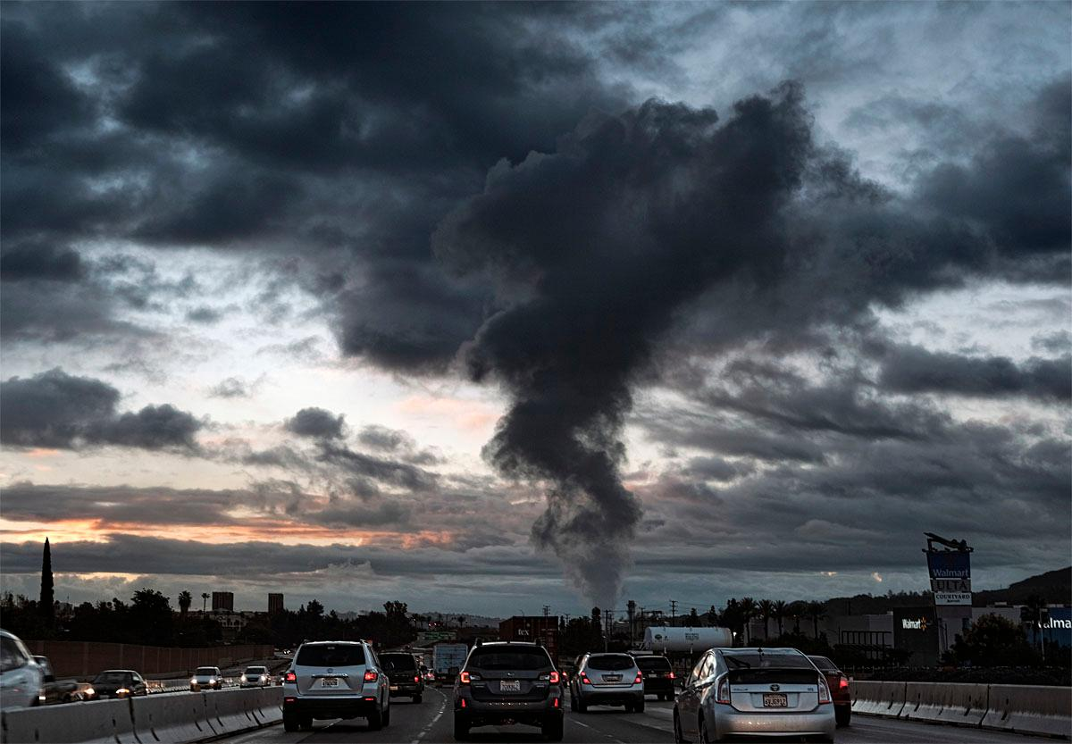 Early morning commuters drive south along Interstate 5, in Burbank, Calif, as storm clouds begin to clear from the sky over downtown Los Angeles on Monday, Nov. 21, 2016. About an inch of rain fell across much of the Los Angeles area beginning Sunday, according to the National Weather Service. The rain was much heavier to the north, with 2.2 inches reported at a mountain weather station in San Luis Obispo County between Los Angeles and San Francisco. (AP Photo/Richard Vogel)