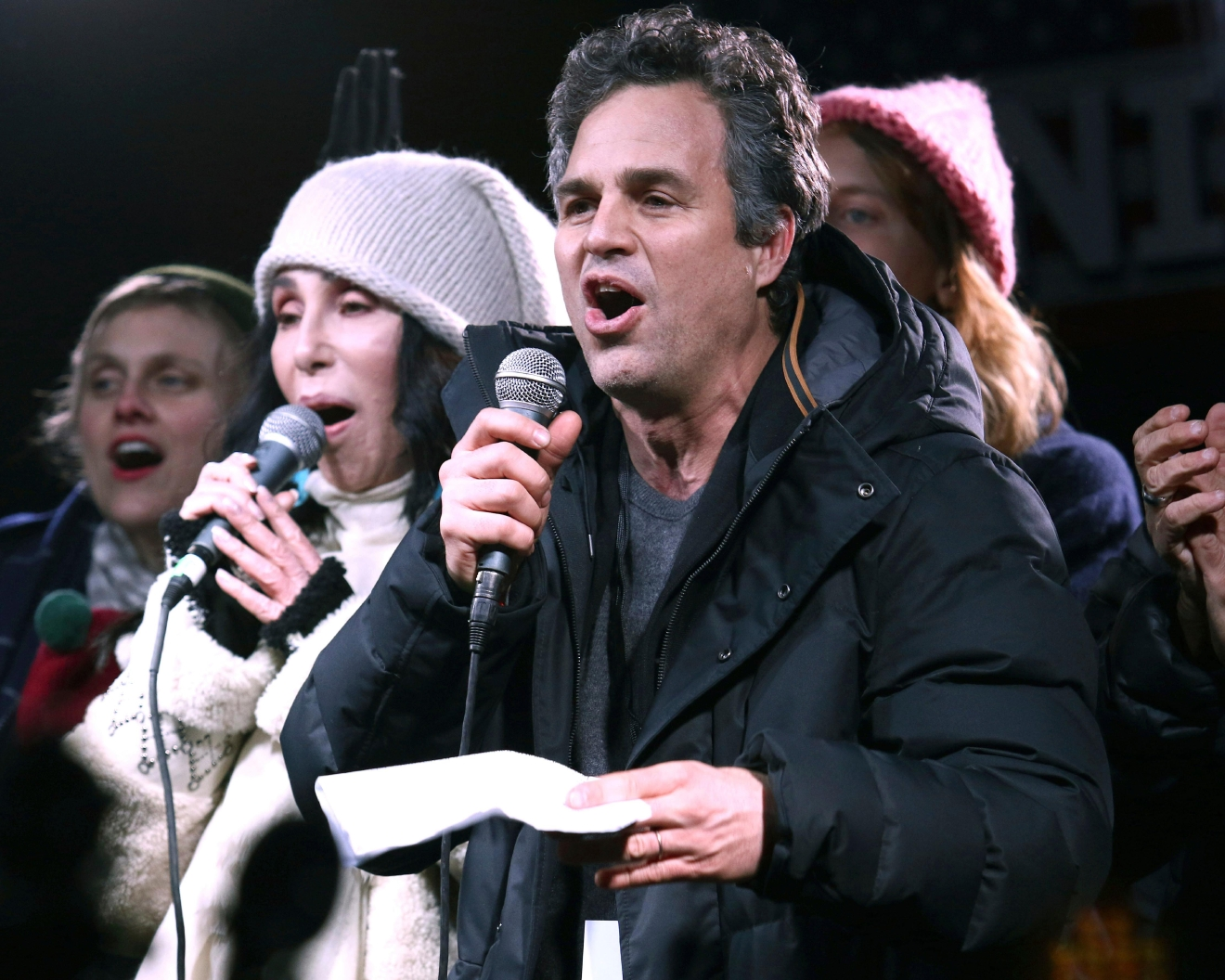 "Cher, left, and Mark Ruffalo participate in the ""We Stand United: New York Rally to Protect Shared Values"" on Thursday, Jan.19, 2017, in New York. (Photo by Greg Allen/Invision/AP)"