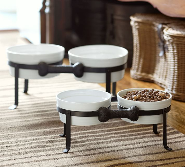 Dog Bone Pet Bowl Stand from Pottery Barn ($39.50 – $49.50). Find on potterybarn.com. (Image: Pottery Barn)